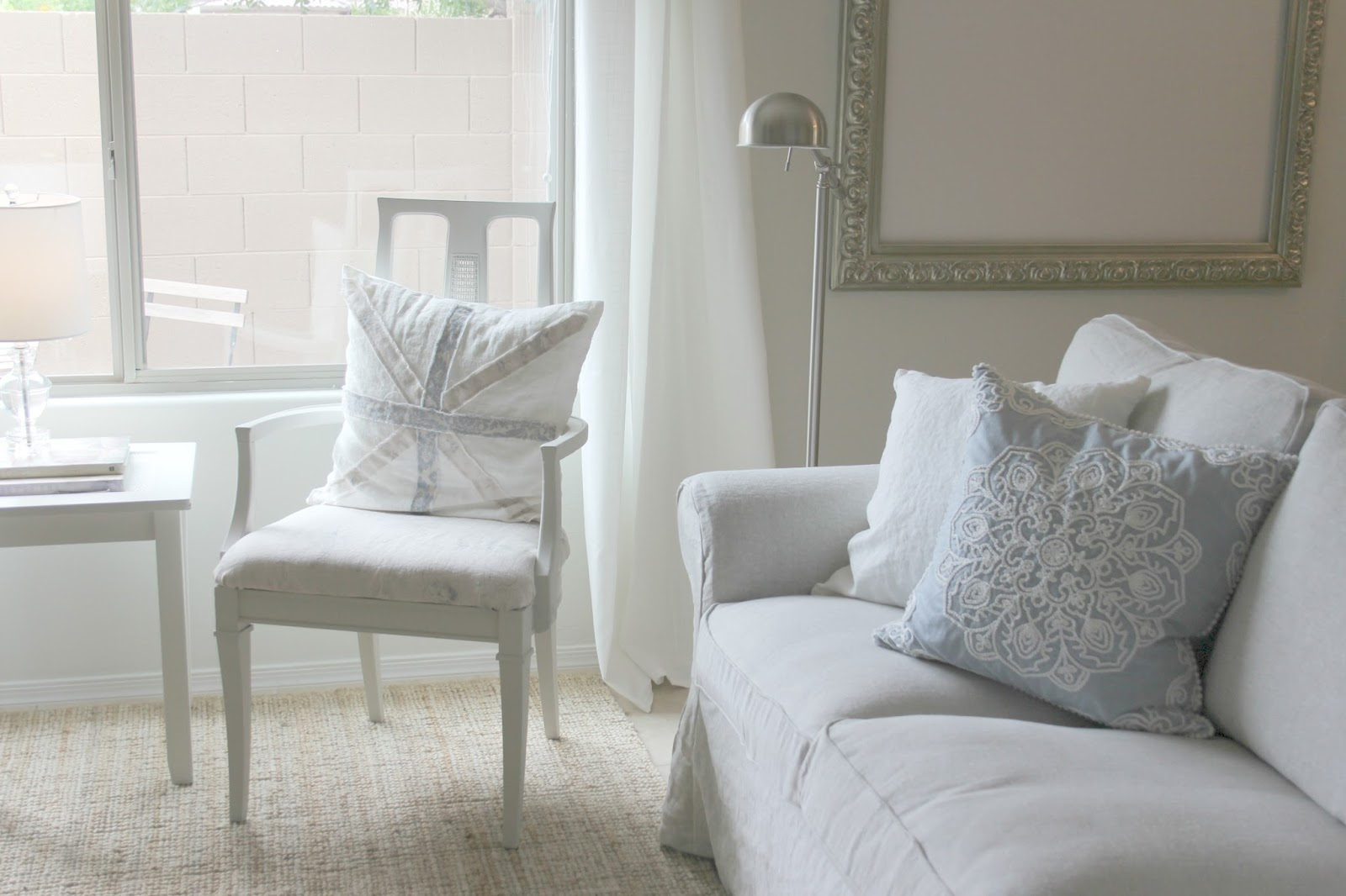Serene neutral living and dining room decor DIY makeover on Hello Lovely Studio
