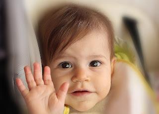 Photo of a child waving