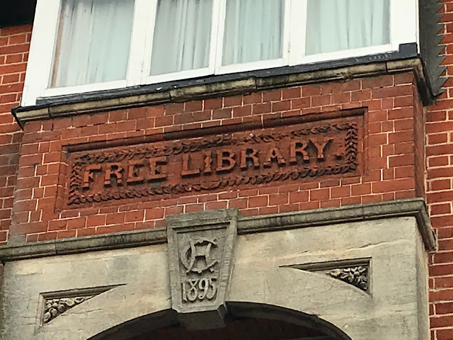 Old sign for former Free Library, Abingdon, Oxfordshire
