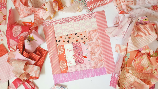 pink log cabin block trimmed