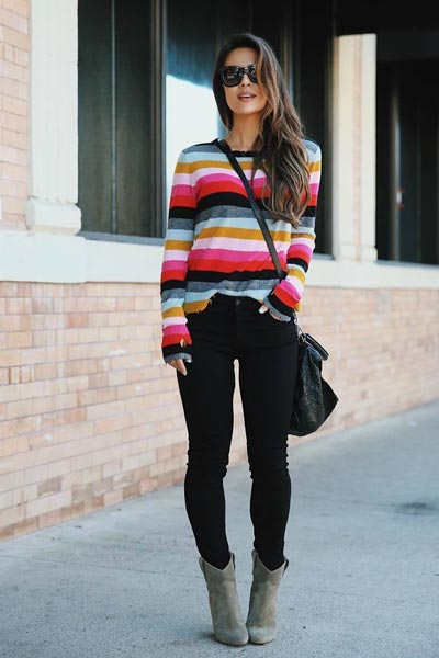 21 Fall Clothing Ideas That are Anything but Boring | Multicolor Sweater + Levi's High Skinny Jeans + Booties + Backpack