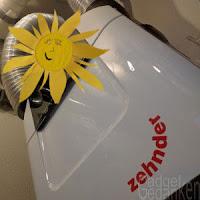 Zehnder Lüftunganlage Q350TR mit symbolischer Sonne im Vordergrund