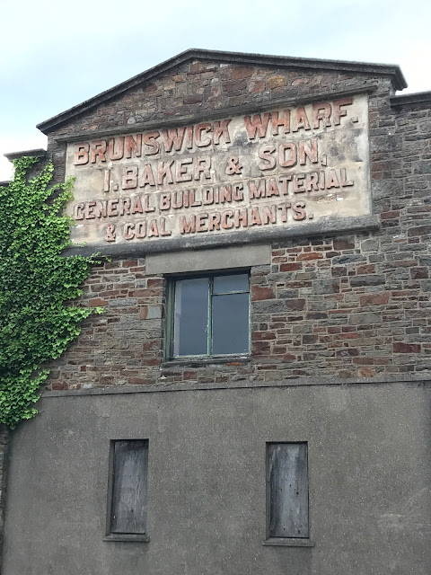 I. Baker & Son ghost sign in Bideford, Devon