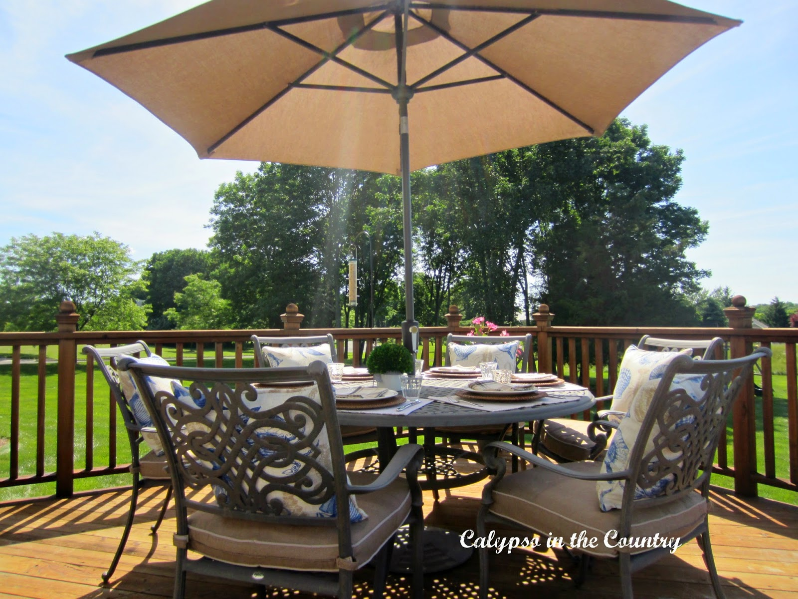 Patio furniture and umbrella - outdoor table setting ideas
