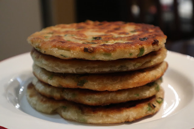 green onion pancakes sitting in a stack