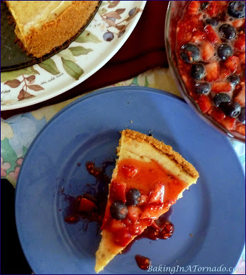 Nothing says summer like berries, and they're bursting with fresh flavor on Cinnamon Cheesecake with Mixed Berries. | Recipe developed by www.BakingInATornado.com | #recipe #bake