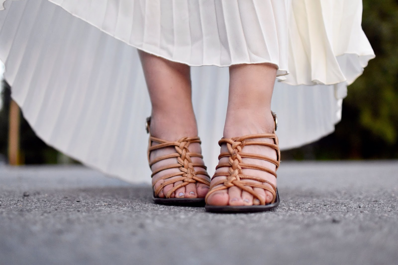 Monika Faulkner personal style inspiration - strappy nude sandals, pleated symmetrical skirt