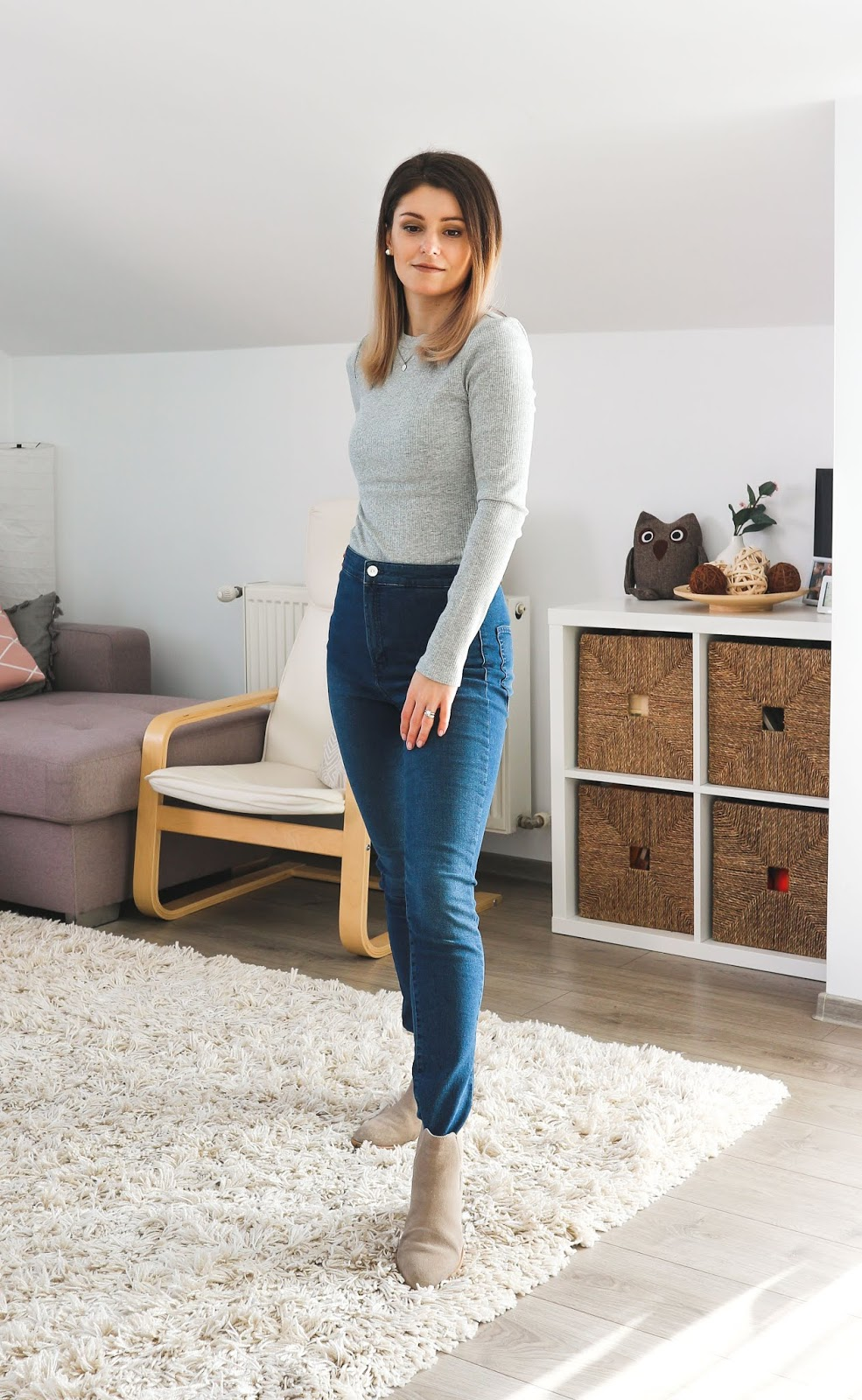 grey ribbed top with jeans and camel ankle boots