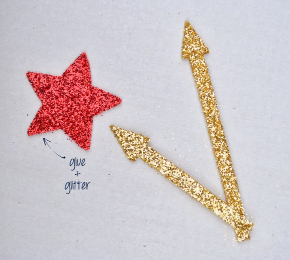 Adorn the clock hands and wooden stars with some festive glue and glitter