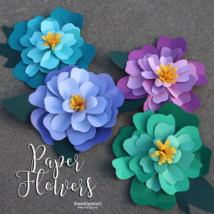 Brightly colored paper flowers cut out of cardstock and hot glued together.