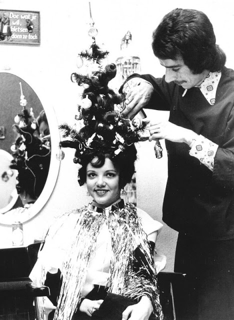 Hairdress creating elaborate Christmas tree hair including ornaments c. 1970s. Yule Lads and other stories of Christmas Creepers. marchmatron.com