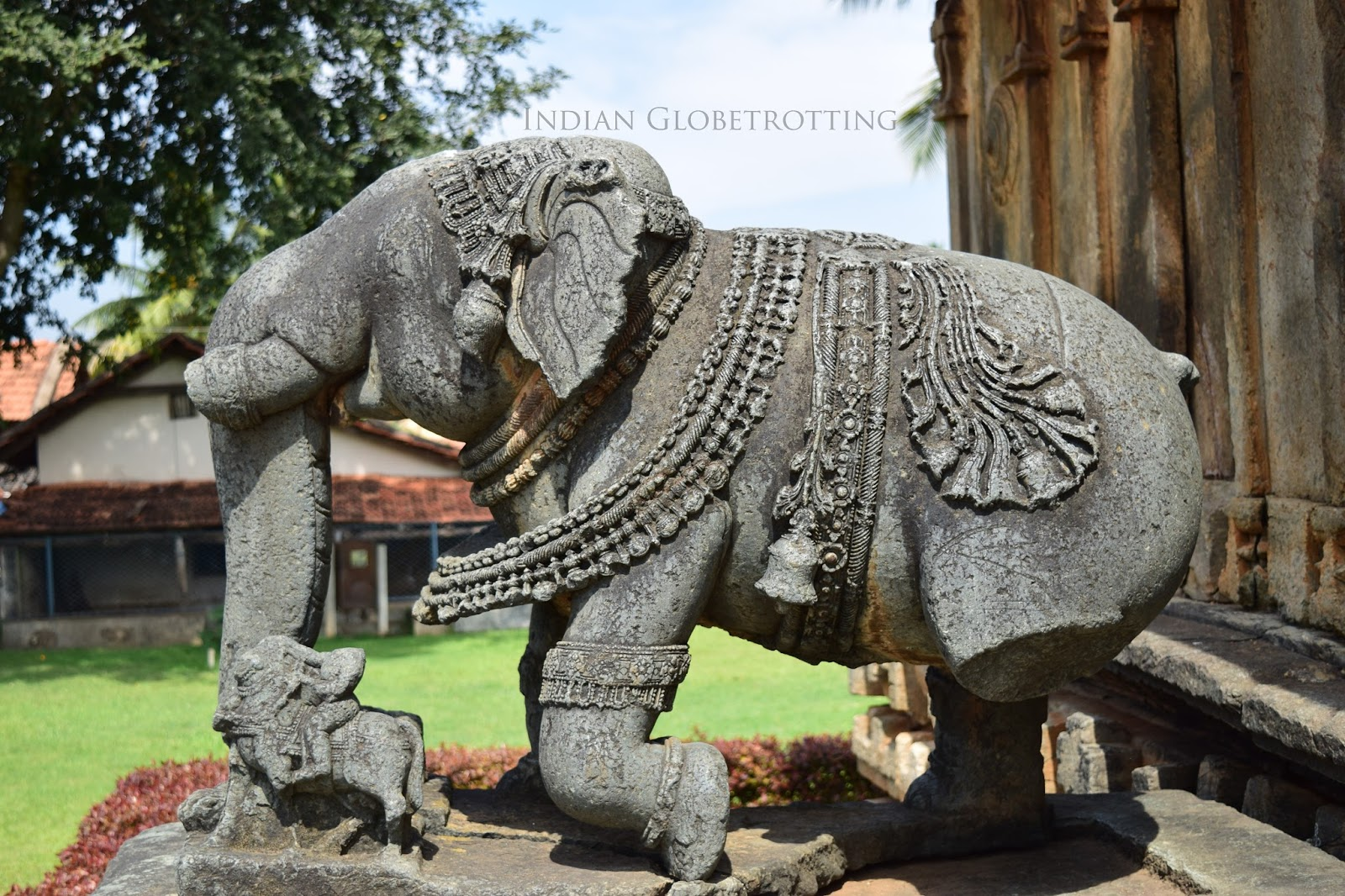 Carved elephant statue at the entry of belavadi veera narayana temple