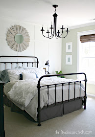 Light green bedroom with white accent