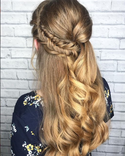 half up hairstyle with braids and twists