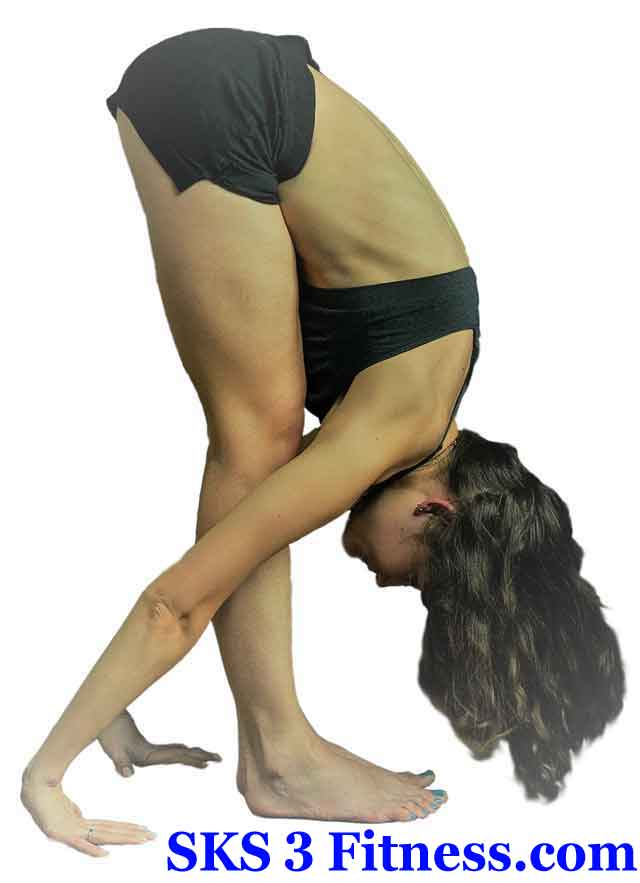 Yoga girl doing Uttanasana - Standing Forward Bend Yoga Pose