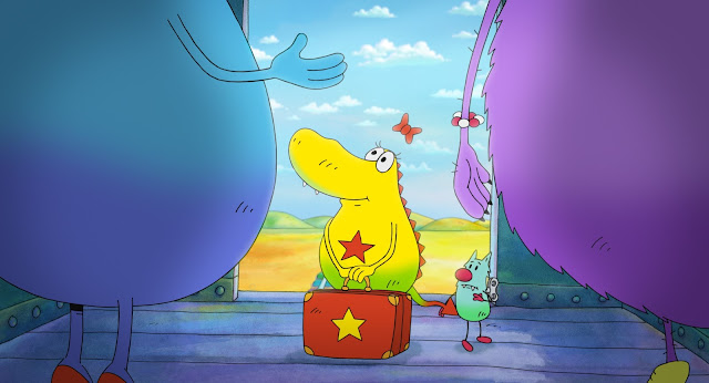 Molly a yellow monster with a red star on and Edison her small blue wind up friend standing on a train