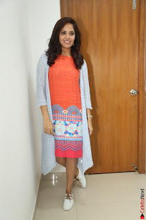 Actress Anasuya Bharadwaj in Orange Short Dress Glam Pics at Winner Movie Press Meet February 2017 (46).JPG