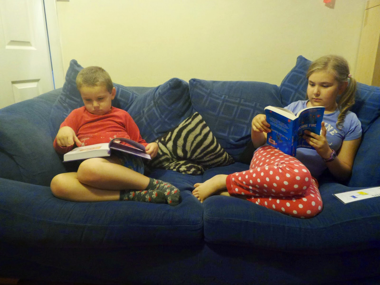 Children reading on the Sofa