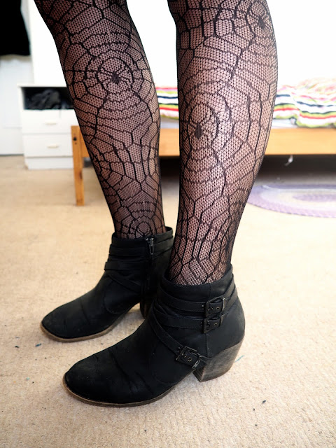 Evil Queen Disneybound villain outfit shoe details of black spider web tights and black heeled ankle boots