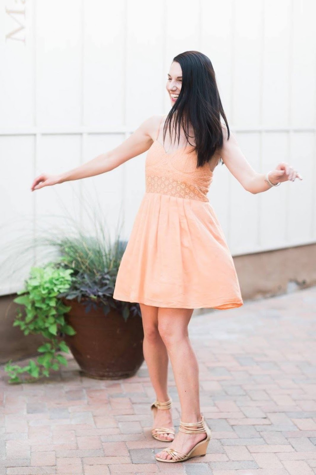 This is a photo of me twirling in an orange lace dress.