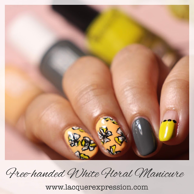 Hand painted white floral summer nail design with peach and chartreuse nail polish