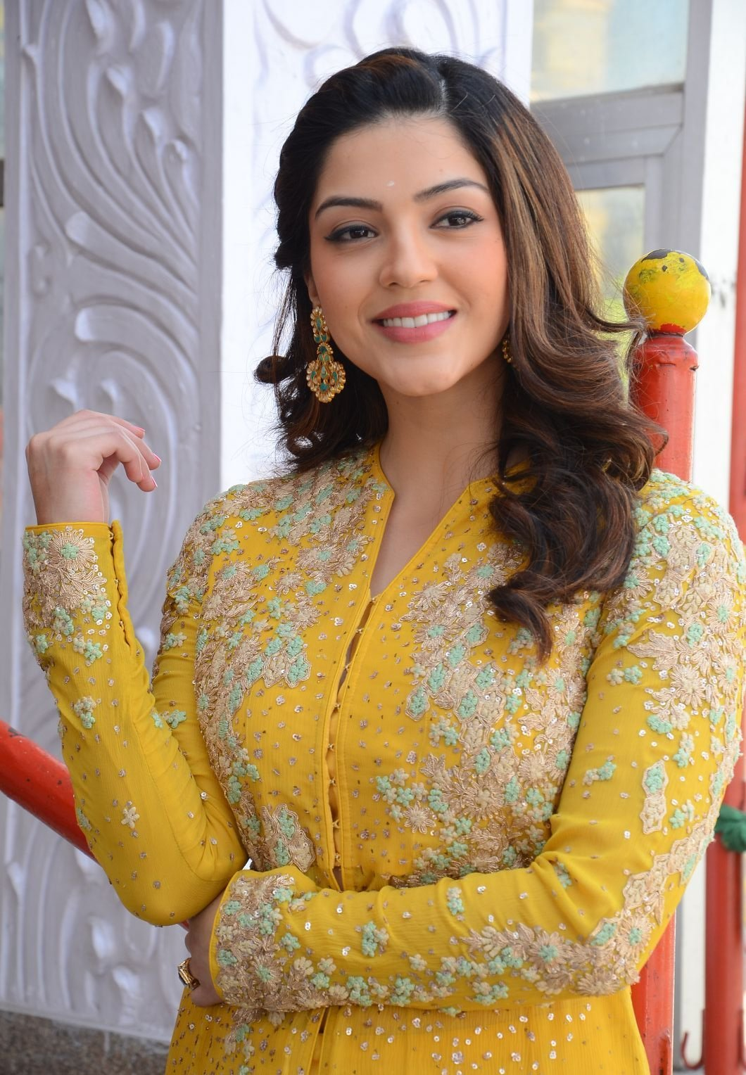 Actress Mehrene Kaur Long Hair Photoshoot In Yellow Dress