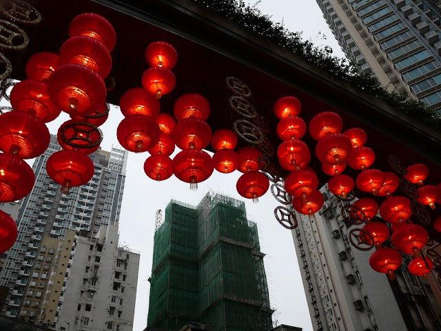 red Chinese lanterns and a building under construction farther away