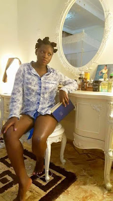 "Photos: ""God First"" - Ugandan socialite shares photos of herself reading the Holy Bible while wearing only a shirt"
