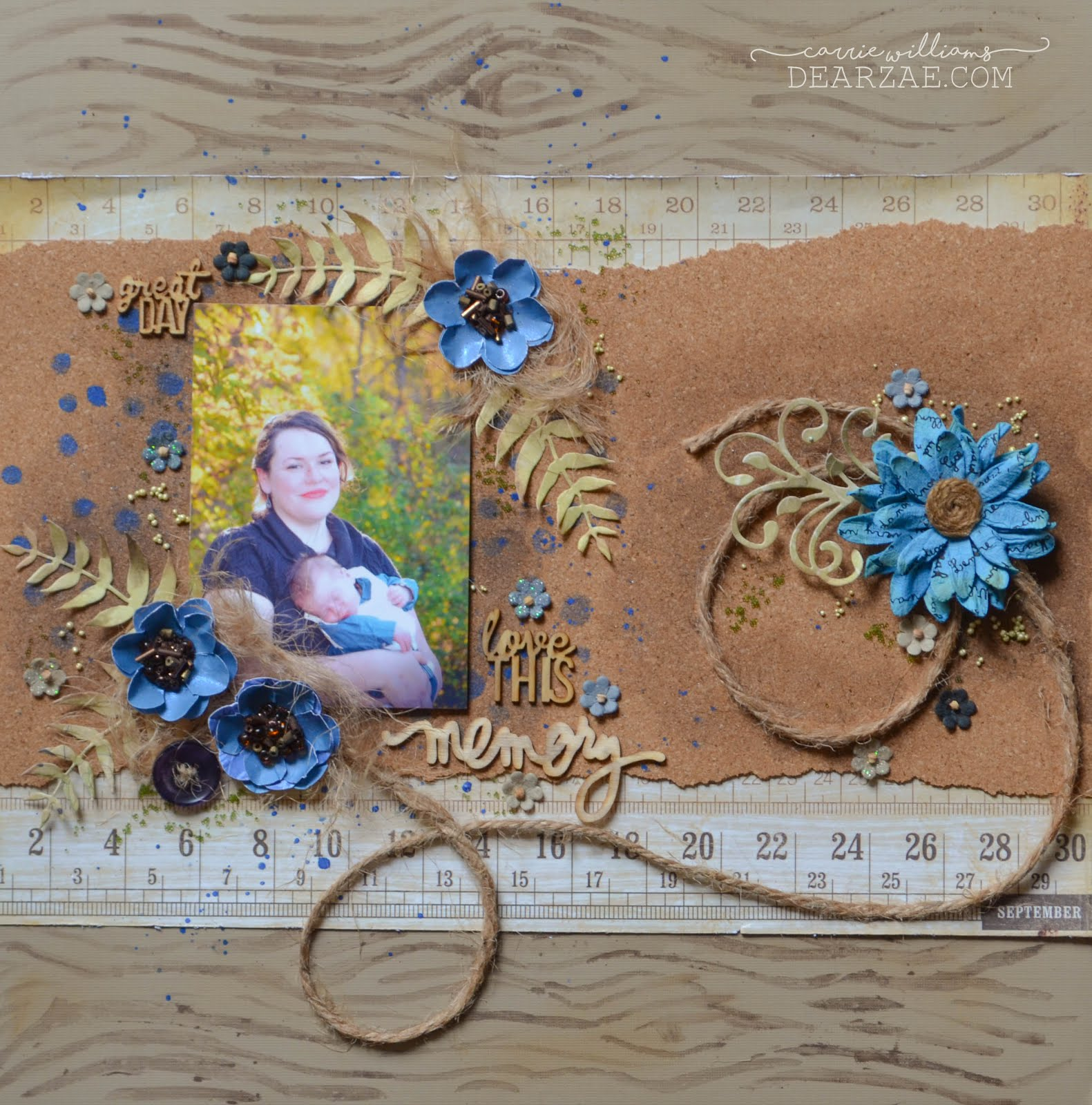 Blue and brown scrapbook layout featuring cork, ruler, rustic handmade flowers, wood veneers, tiny flowers, acrylic paint, and jute string rope with prills and stenciling