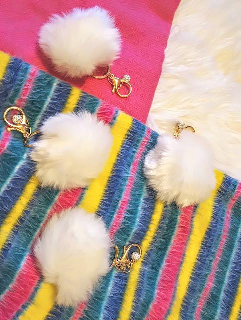 white pom pom keychains
