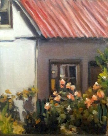 Oil painting of what appears to be a small white cottage with a red roof, with rose bushes in the foreground.