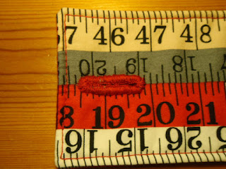 Hand stitched button hole