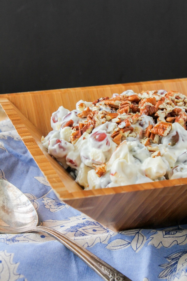 Lighten up your brunch menu with this creamy Apple & Grape Breakfast Salad! Fresh fruit is tossed in a flavorful lemony yogurt sauce that's not only delicious, but healthy too!