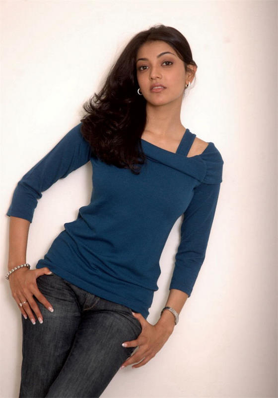 Kajal Agarwal Smiling Stills In Blue Top Black Jeans