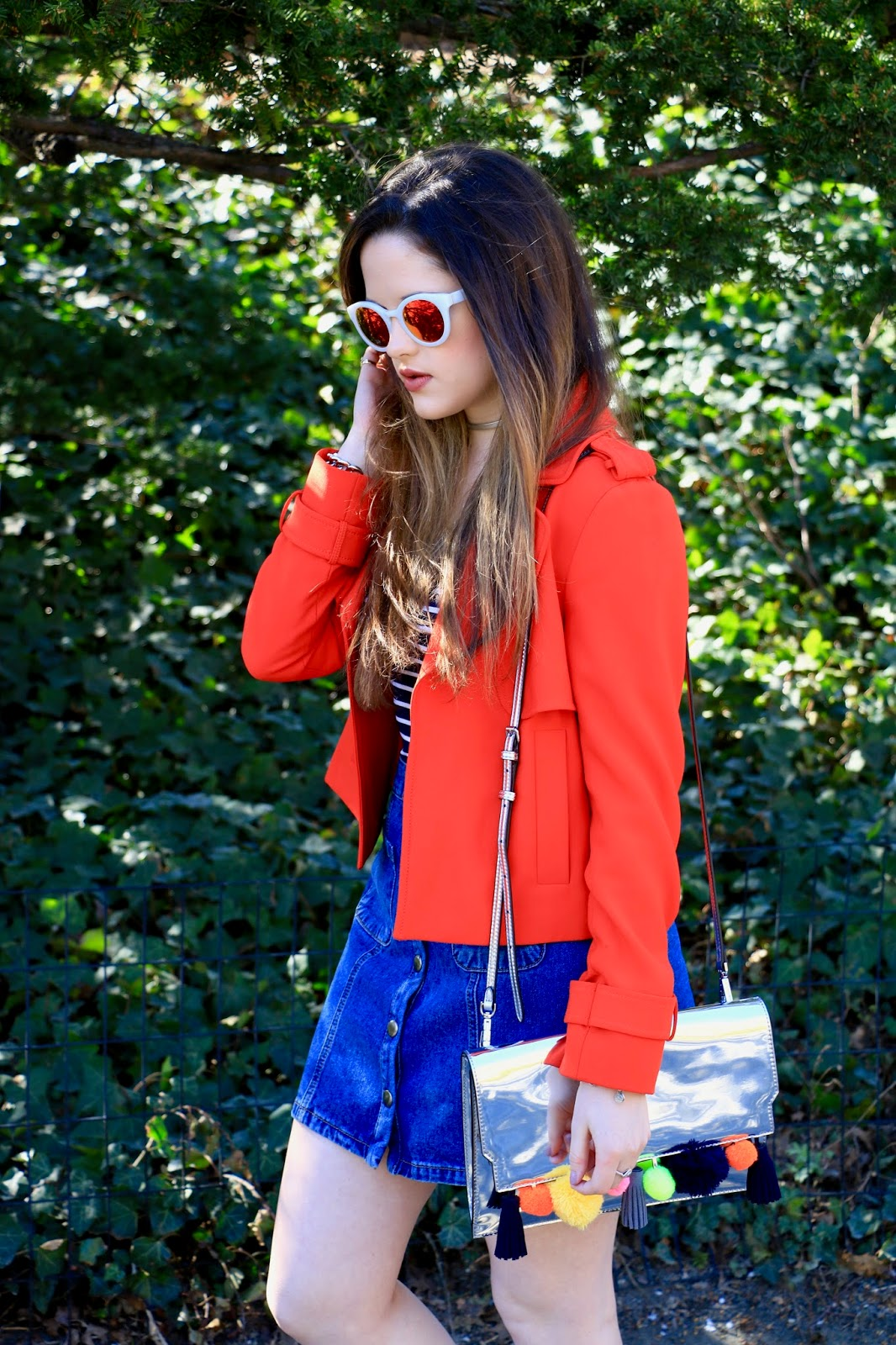 orange jacket worn with denim skirt
