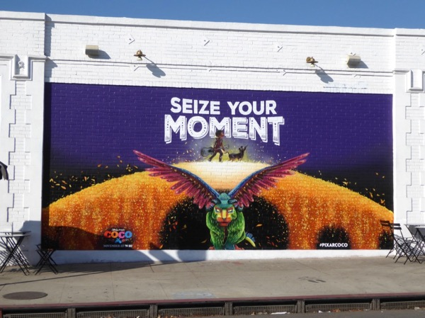 Coco Seize your moment mural ad