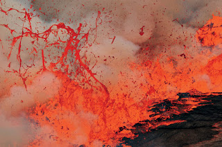 Rising gas bubbles explode, splattering lava , 60 feet,Nyiragongo's , lake.