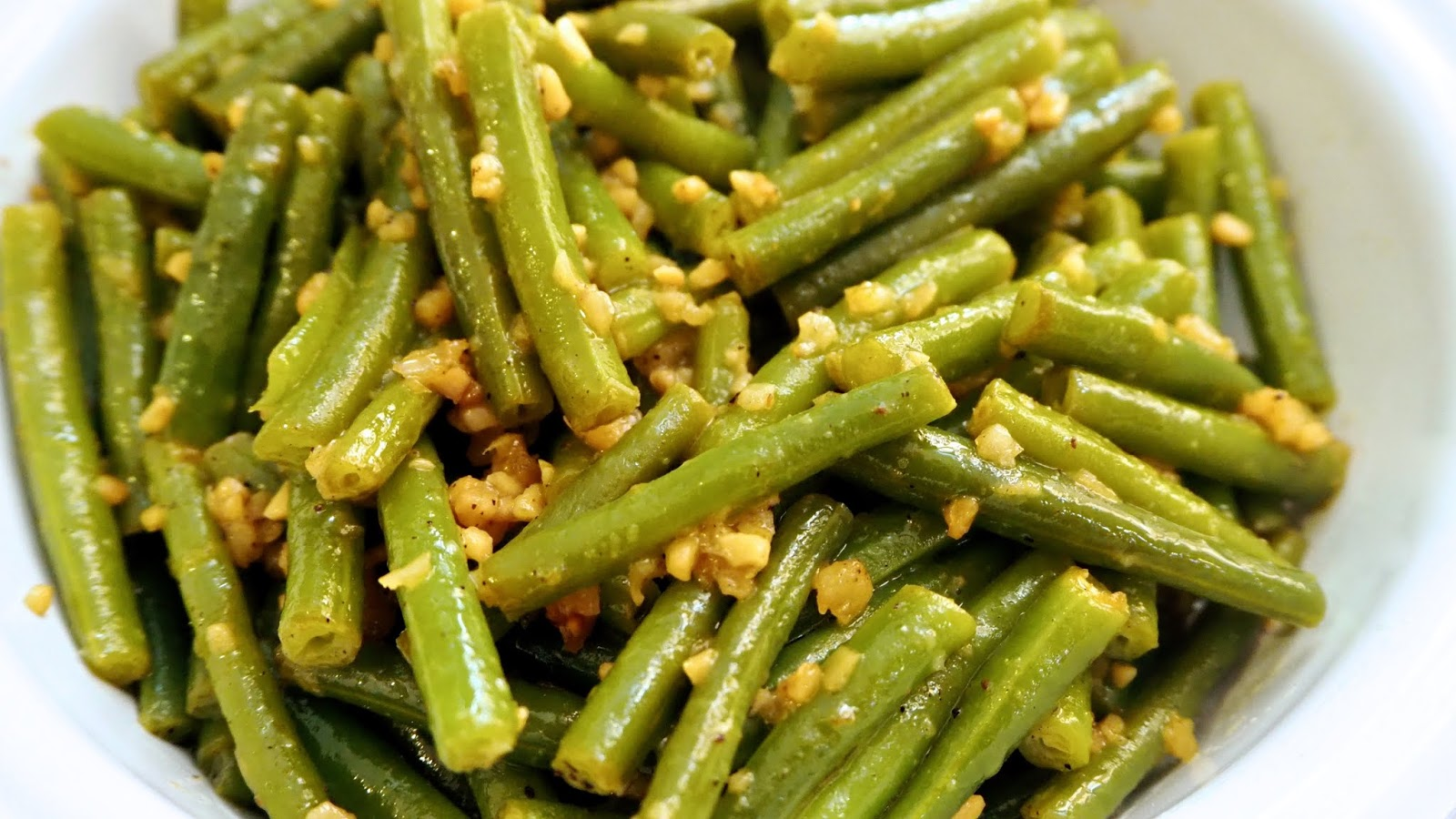 close-up of garlic and lime green beans