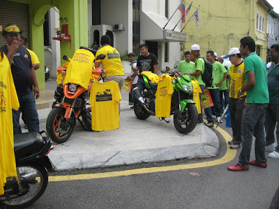 Himpunan Kebangkitan Rakyat - hawker selling Yellow T-shirts from motorcycles