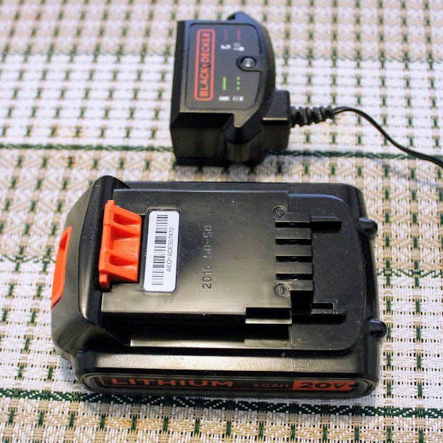 Black & Decker 3 in 1 Cordless Mower - The second picture of the The lithium battery and charging dock.