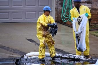 Two years ago, a ruptured ExxonMobil pipeline sent a river of oil into a Mayflower, Ark., neighborhood, uprooting 22 families. The Pegasus pipeline failure became a cautionary tale that exposed—not for the first time—critical limitations of today's pipeline safety regulations. (Credit: Workers clean up the March 29, 2013 oil spill in Mayflower/Faulkner County Concerned Citizens Advisory Group) Click to Enlarge.