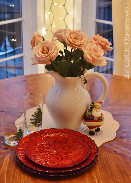 Christmas Table Setting With White Roses and Red Glass Dishes