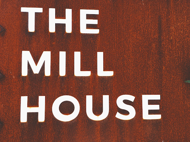 The Mill House sign