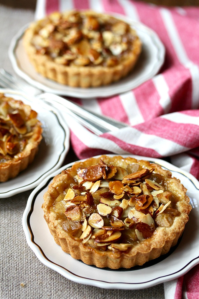Individual apple tarts with almond topping