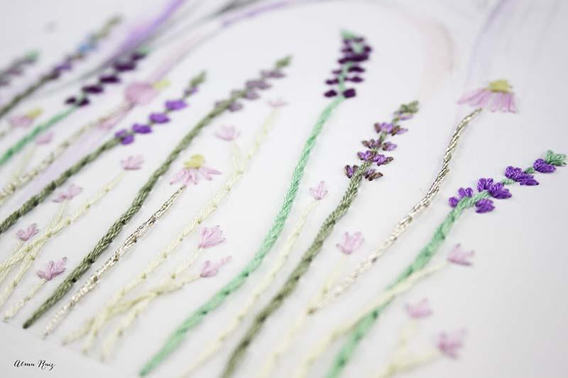 Flores bordadas a mano en papel