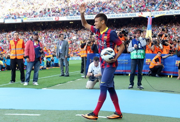 Neymar enters the Camp Nou pitch after being announced as the newest member of Barcelona