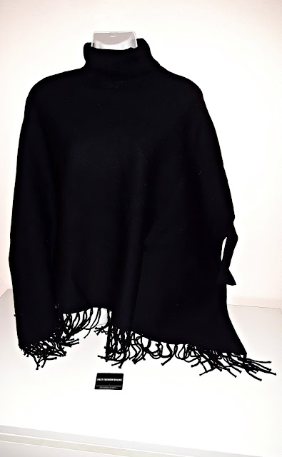 http://it.shein.com/Black-Turtle-Neck-Batwing-Sleeve-Fringe-Cape-Sweater-p-317850-cat-1734.html