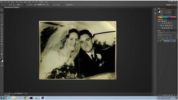 Restoring Damaged Photographs