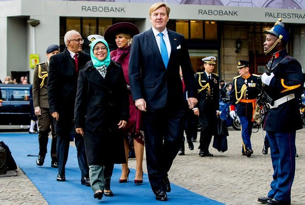 Dutch Queen Maxima wore Natan coat and Natan Pumps and she wore Saloni floral satin asymmetric dress