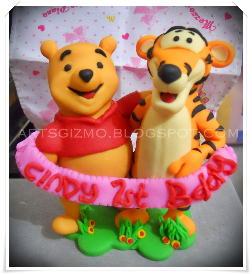 This Is A Cake Topper For 1 Year Old Little Girl Winnie And Tigger Actually Holding Banner With The Word Cindy 1st Bday